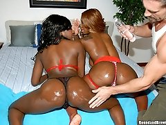 These 2 amazing ebony asses are all lubed up and ready to get fuckd in these hot pics